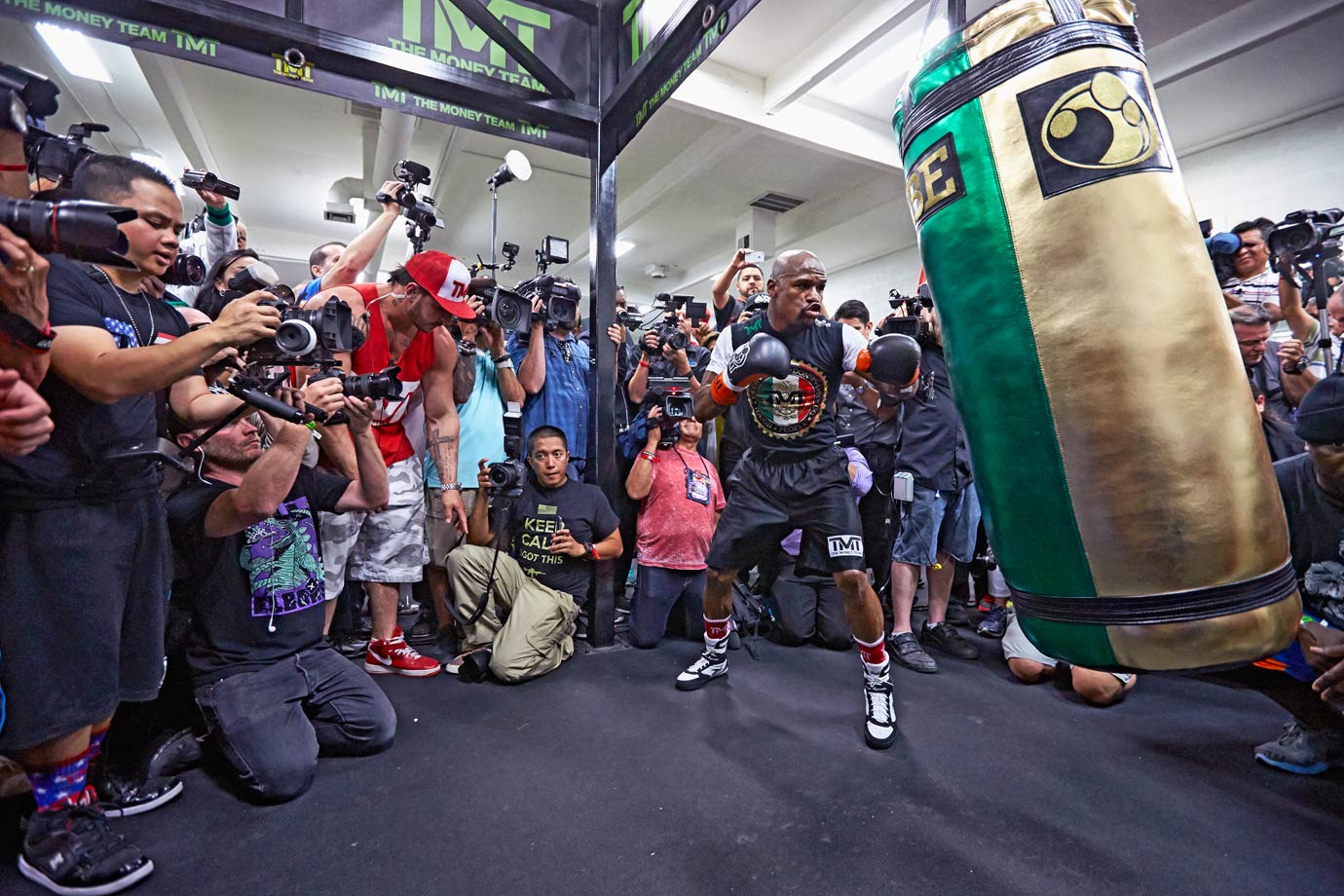 But good luck finding many similarities between those sweaty dens and the camp's glitzy pre-Pacquiao camp at the Mayweather Boxing Club in Las Vegas. There Money did what he does best—played to the cameras...