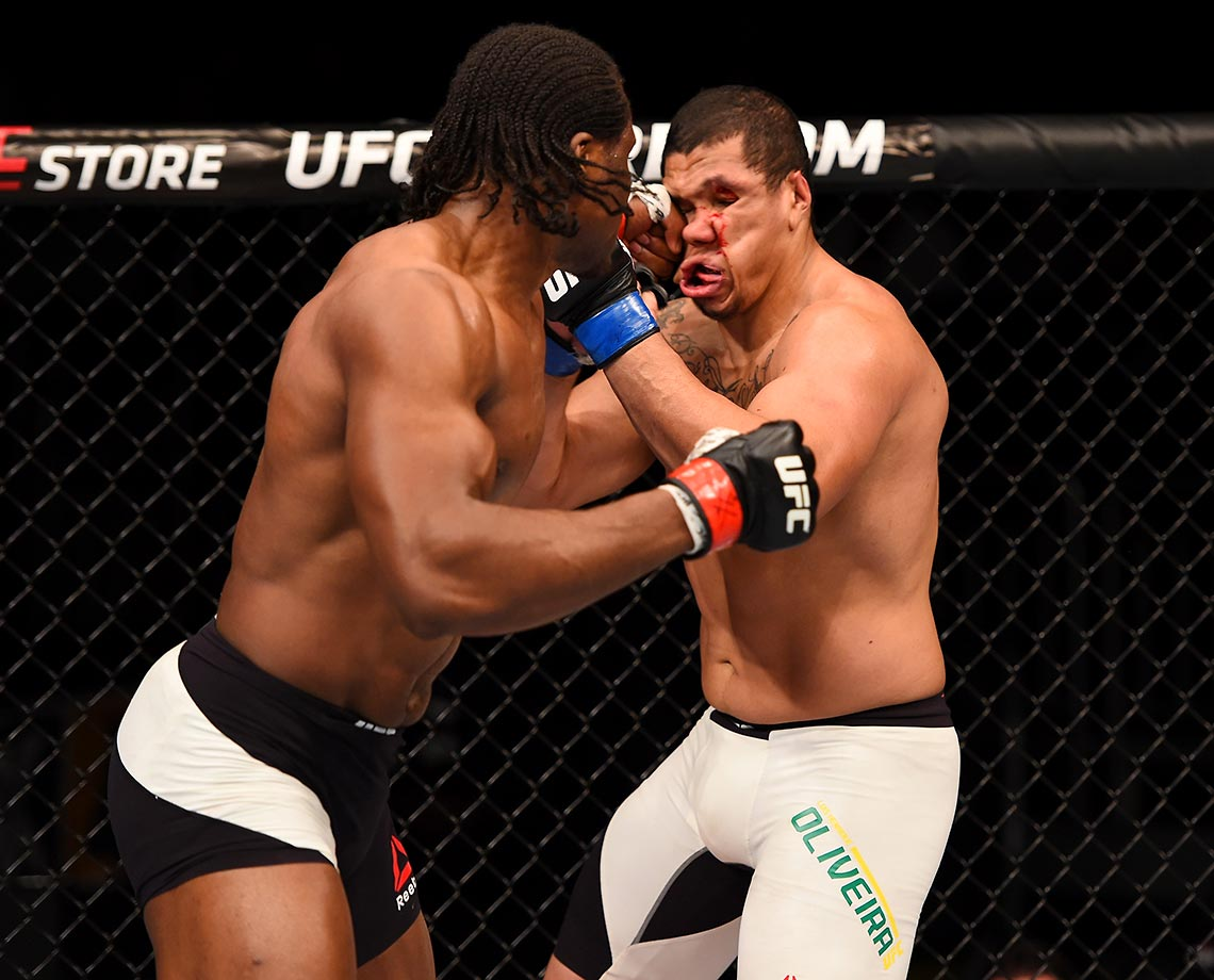 Francis Ngannou punches Luis Henrique in their heavyweight bout during the UFC Fight Night in Orlando.