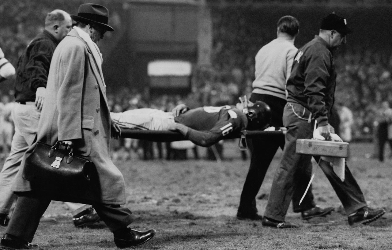 Gifford is taken from the field after being hit by Chuck Bednarik of the Philadelphia Eagle, to stop the last chance the New York Giants had of coming back and tying the score during a November 1960 game at Yankee Stadium.  Gifford was knocked unconscious as the Eagles beat the Giants, 17-10.