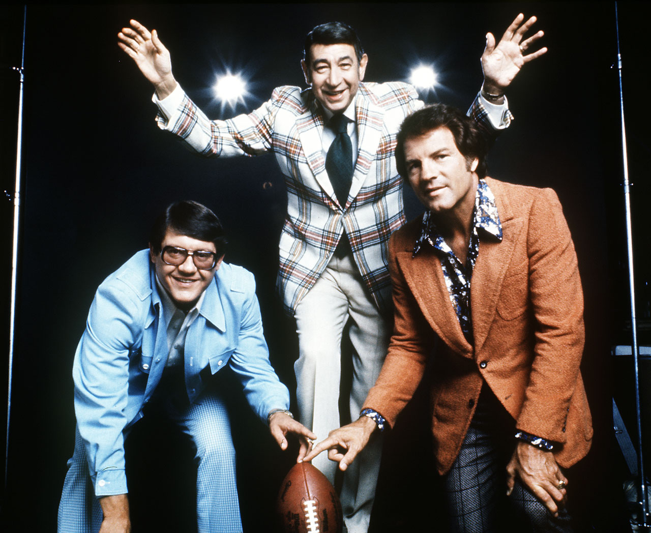 NFL commentators Alex Karras, Howard Cosell and Frank Gifford in 1975.