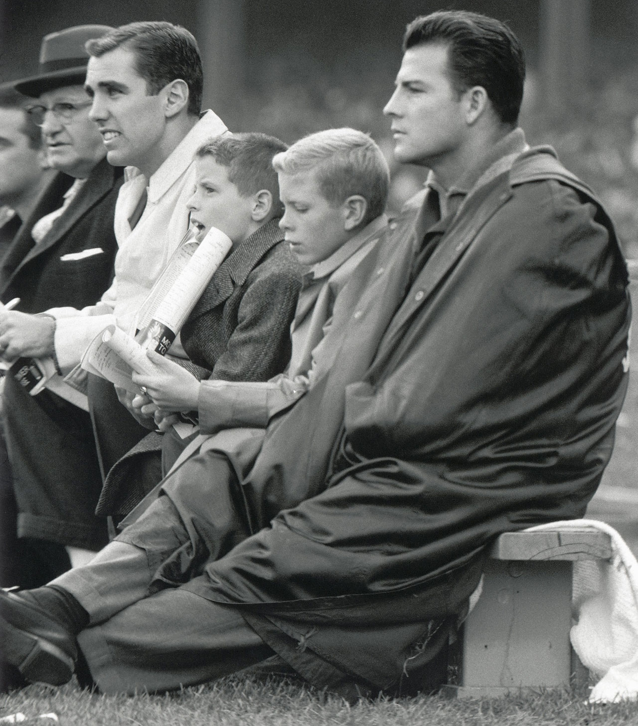 Frank Gifford watches from the bench during a 1959 game at Yankee Stadium.