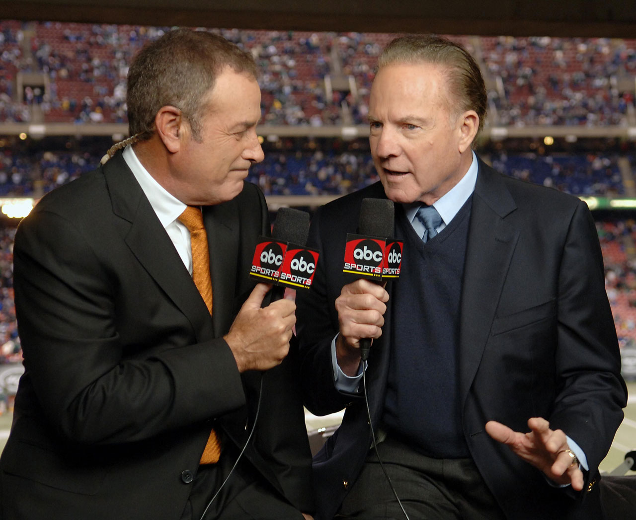 Al Michaels, left, and his former 'Monday Night Football' announcing partner Frank Gifford talk over their experiences at halftime of the last ABC Monday Night Football game telecast, between the New England Patriots and the New York Jets, at Giants Stadium on Dec. 26, 2005.