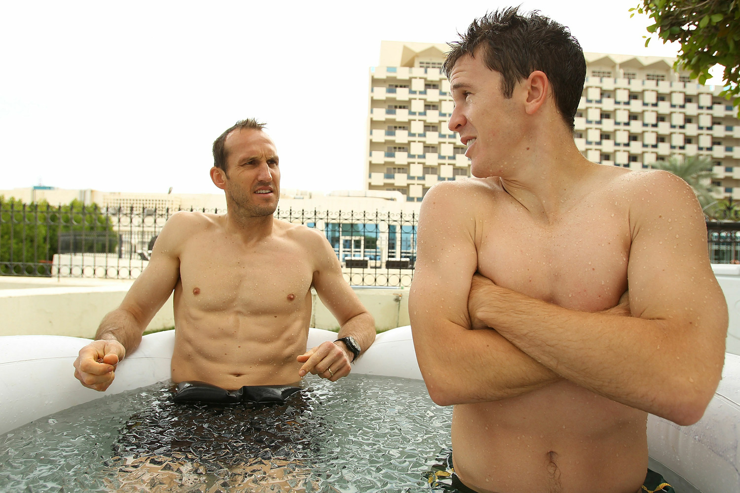 Goalkeeper Mark Schwarzer and midfielder Matt McKay sit in an ice bath during an Australian Socceroos recovery session at the Marriott Hotel in January 2011.