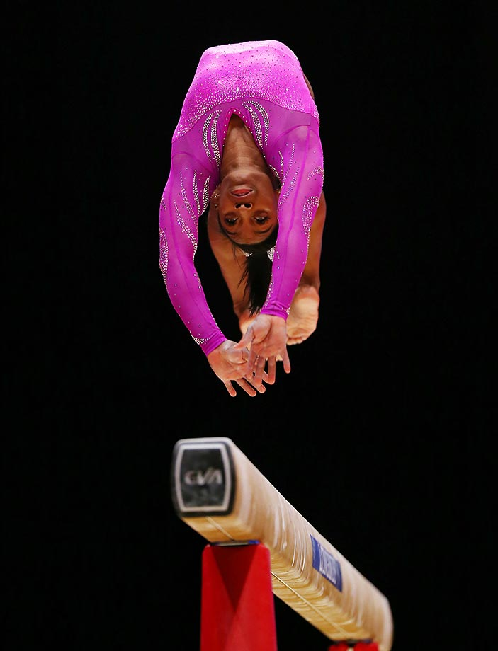 Gabby Douglas competes on the beam during Day 2 of the 2015 World Artistic Gymnastics Championships in Glasgow, Scotland.