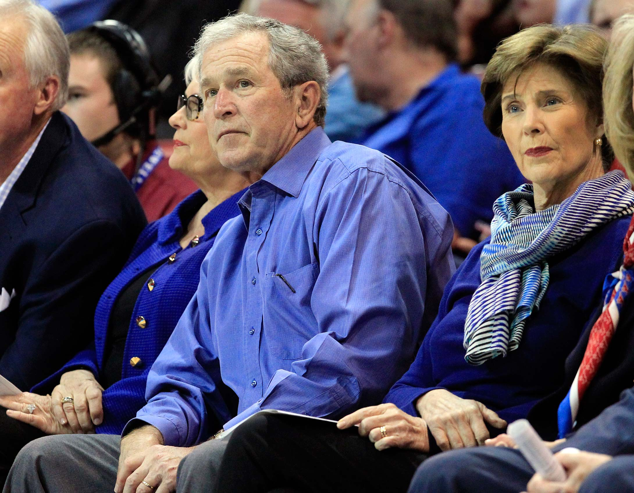 Former president George W. Bush and wife Laura watch a 2014 game between SMU and Houston  in Dallas.