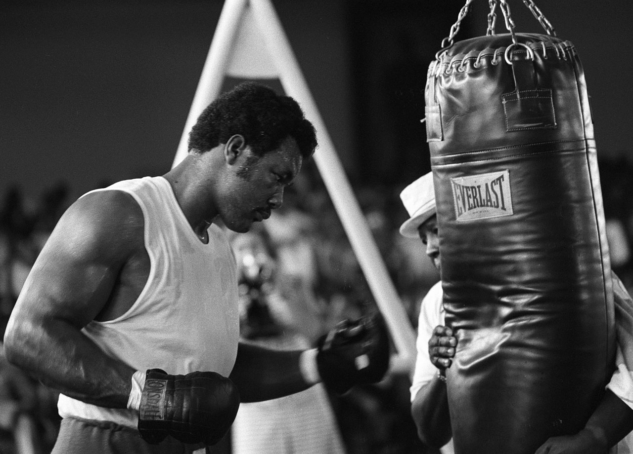 George Foreman hits a heavy bag while training at the Salle de Congres in the presidential complex outside of Kinshasa, Zaire.