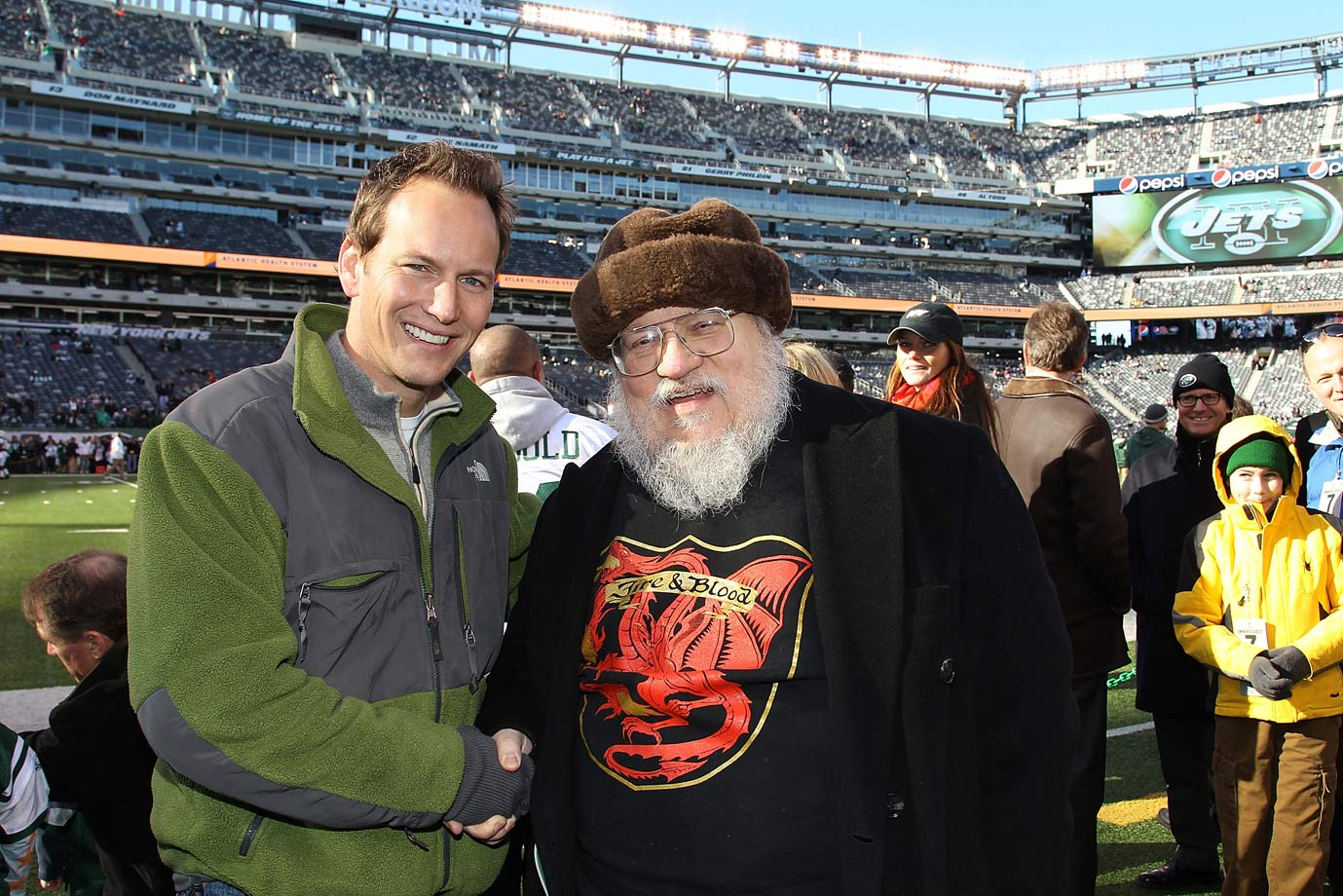 George R.R. Martin poses with Patrick Wilson as they attend an NFL game between the New York Jets and Kansas City Chiefs at MetLife Stadium on Dec. 11, 2011 in East Rutherford, N.J.