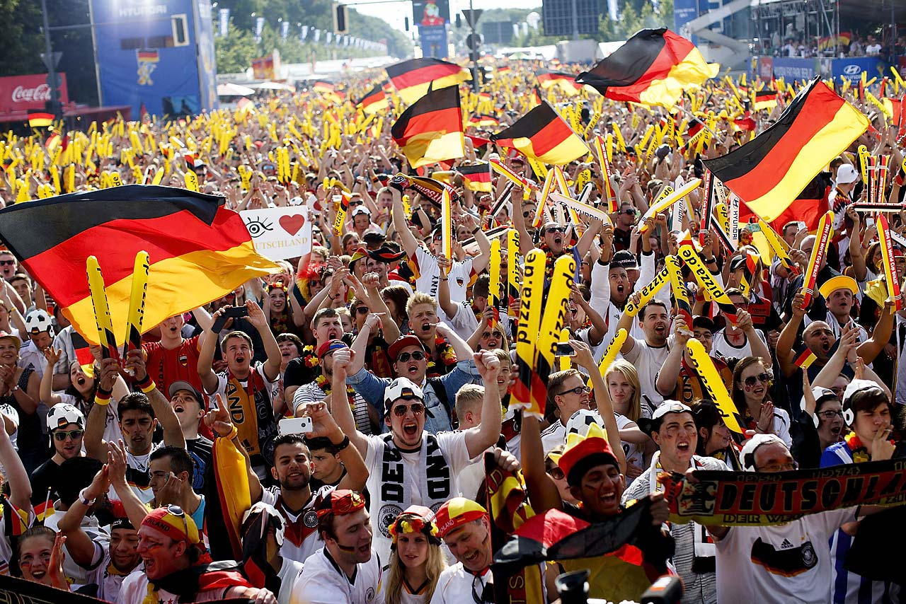 German fans gather in Berlin and celebrate as they watch Germany defeat Portugal 4-0 in their first match of the 2014 World Cup.
