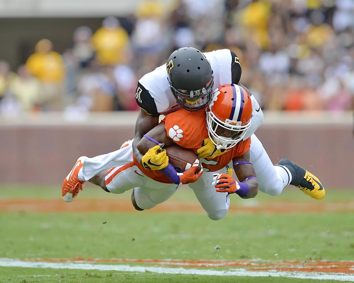 Germone Hopper of Clemson is tackled by Doug Middleton of Appalachian State.