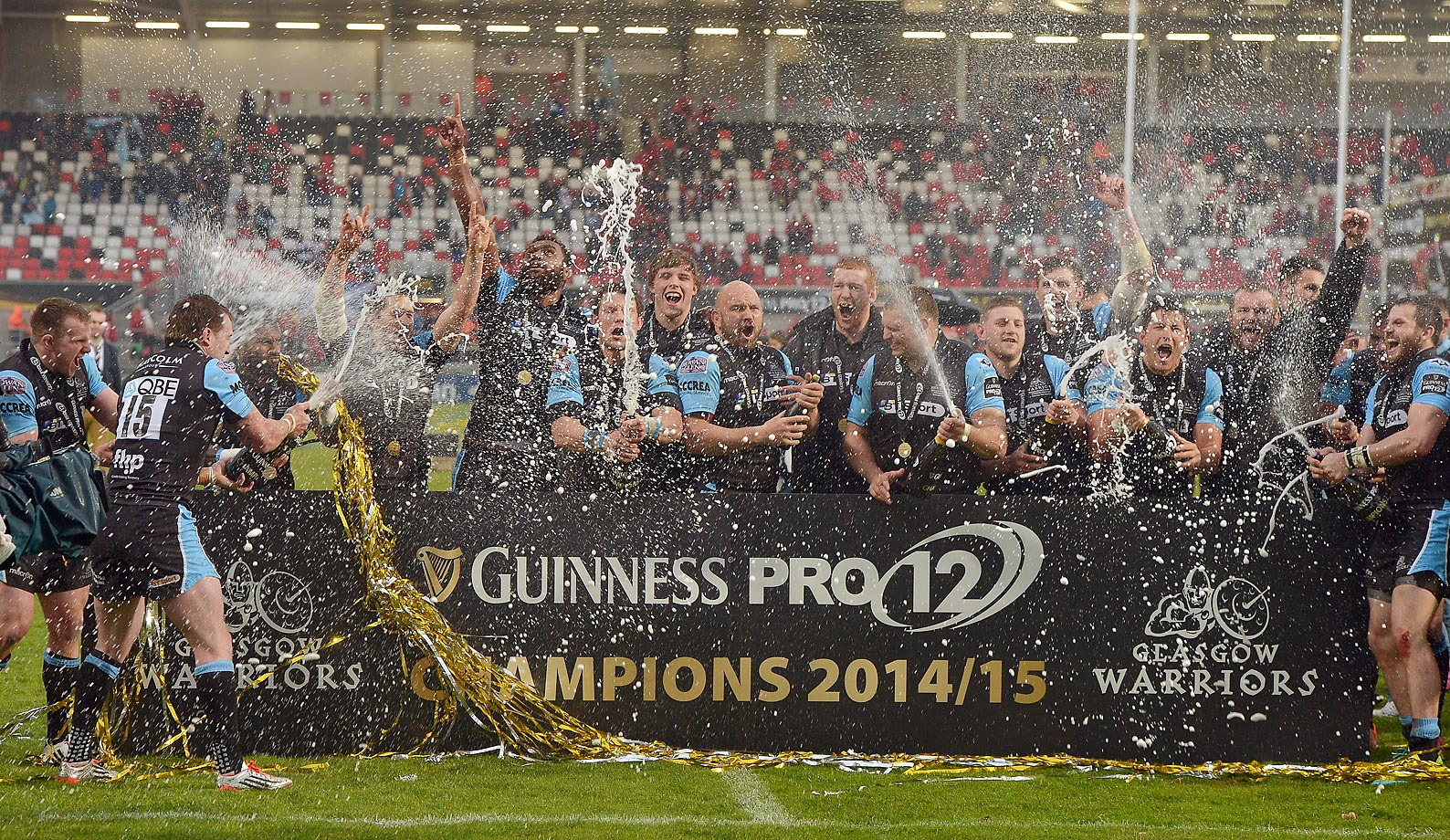 Glasgow Warriors players lift the Pro 12 trophy after their team's victory in the Guinness Pro 12 final match.