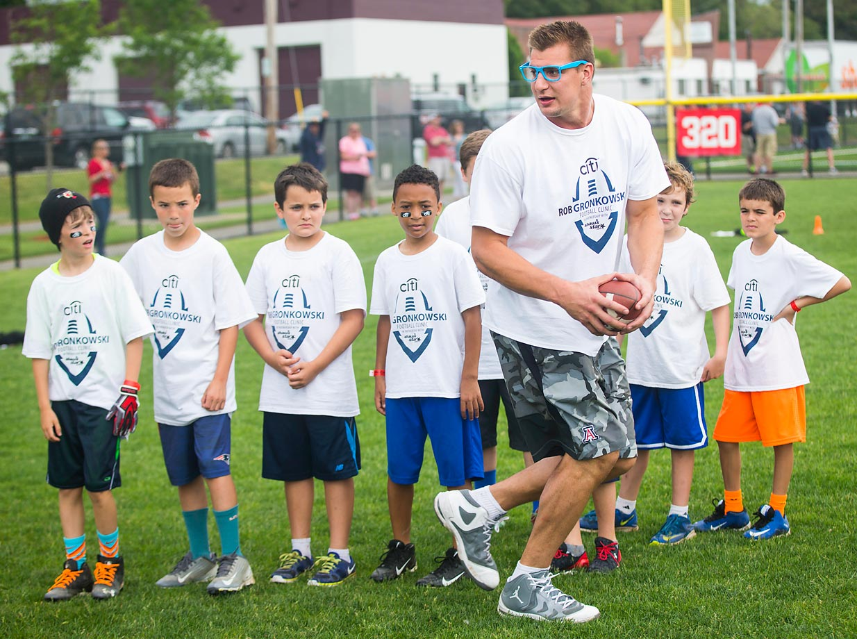 Rob Gronkowski of the New England Patriots leads campers at a football camp in Melrose, Mass.