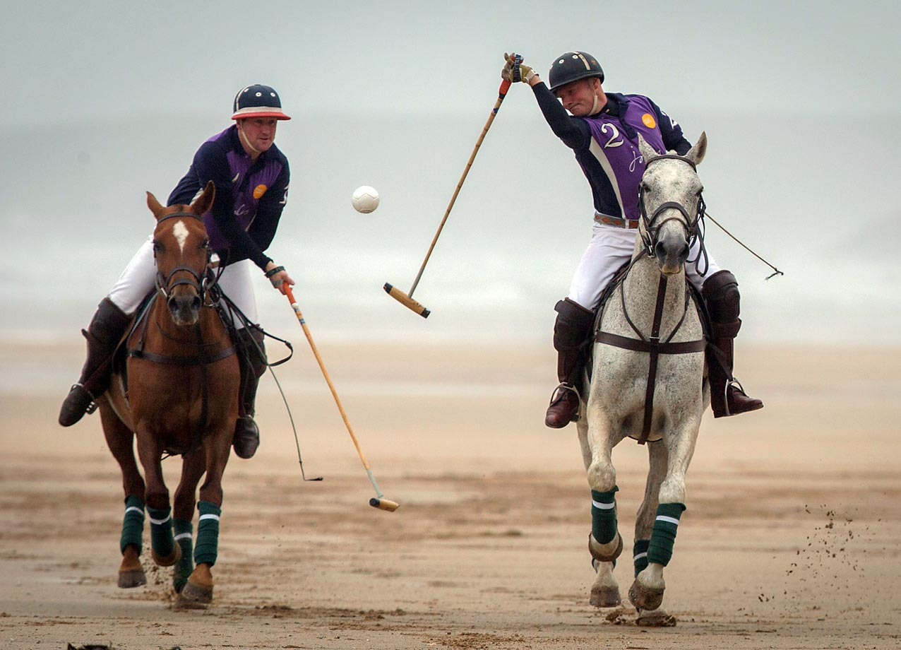 Andy Burgess and Daniel Loe practice for the 9th annual GWR Polo on the Beach competition in England.