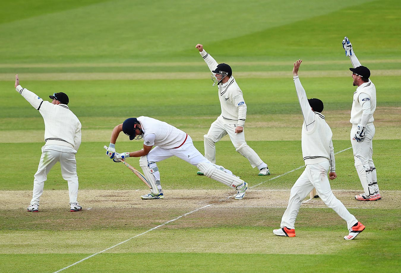 England's Alastair Cook loses his wicket for 56, trapped lbw (Leg before wicket) by Kane Williamson of New Zealand on day five of the second Test match between England and New Zealand.