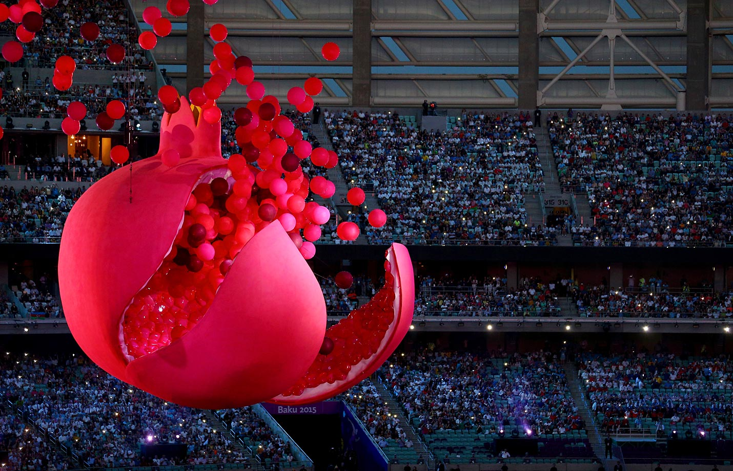 A giant Pomegranate representing abundance, rebirth, love and good luck splits open to release its seeds during the Opening Ceremony for the Baku 2015 European Games.