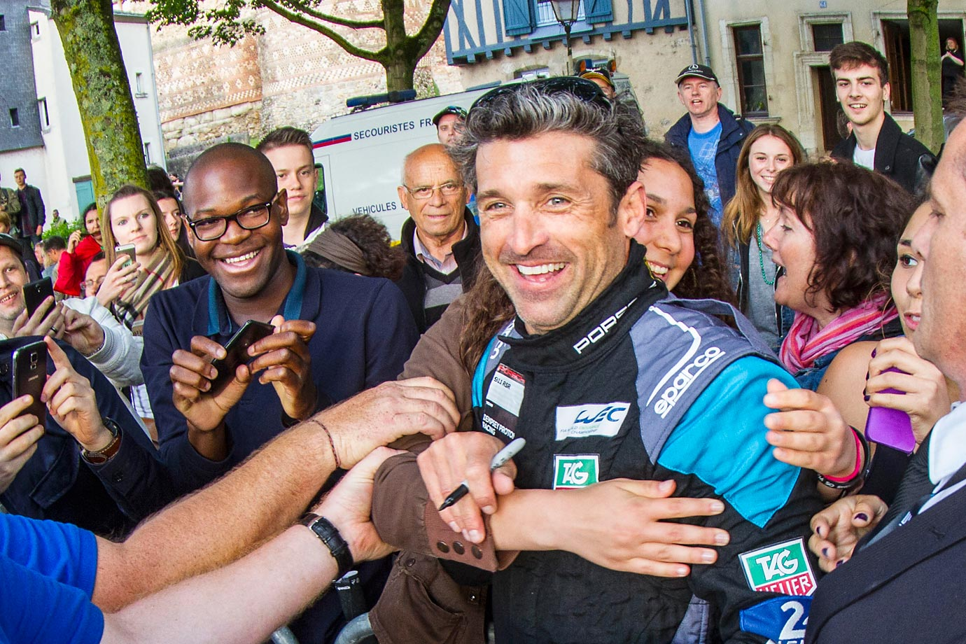 "Patrick ""McDreamy"" Dempsey gets a hug from a fan during the driver's parade at the the 24 Hours of Le Mans."