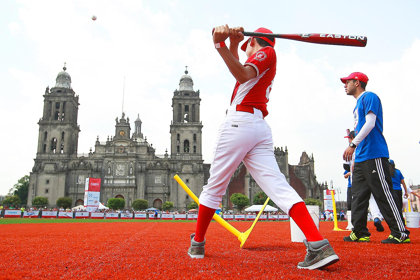 A kid bats a baseball during the Home Run Derby as part of Mexican Baseball League 90th anniversary celebration.