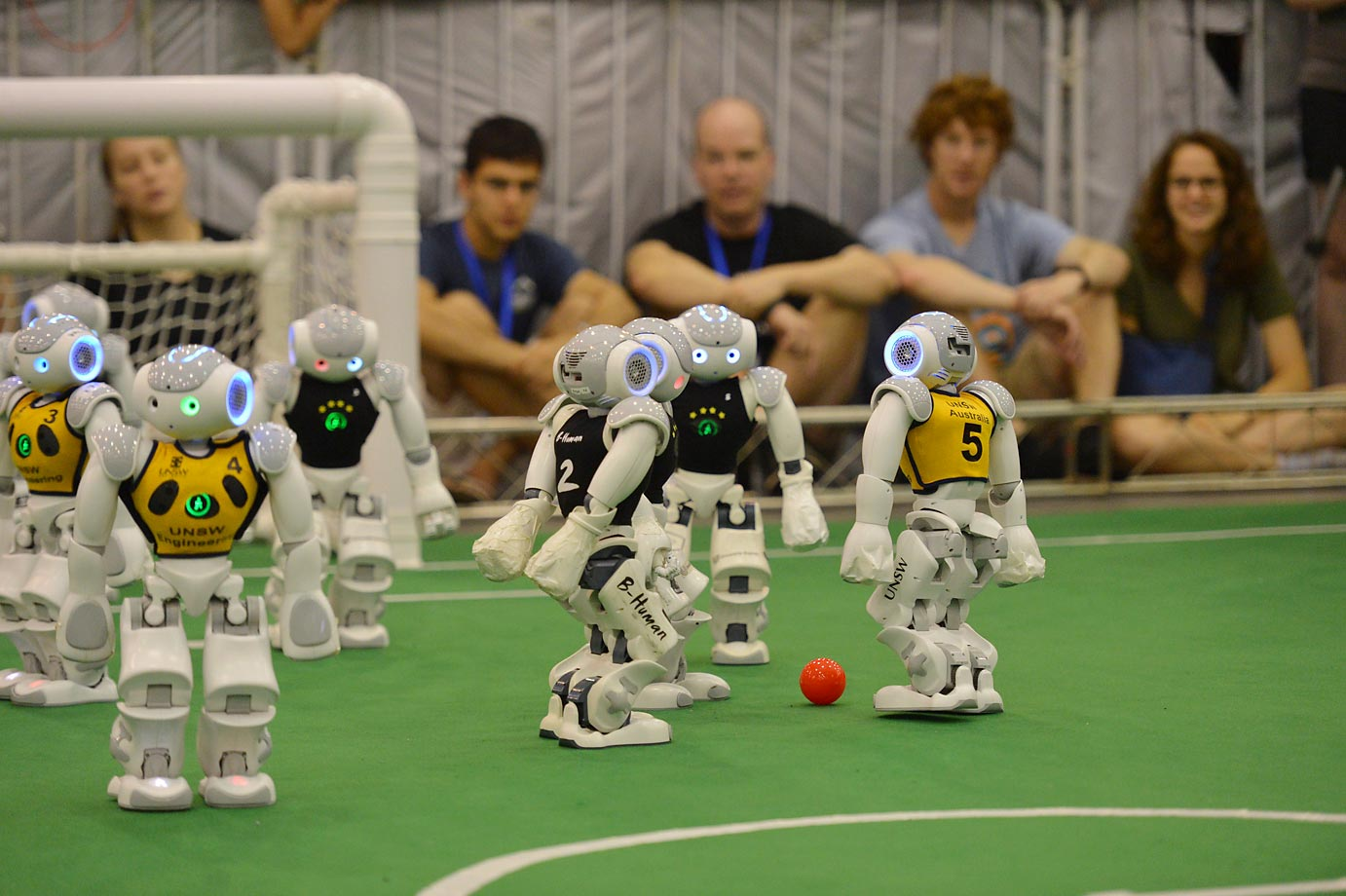 Robots compete in a football match during the RoboCup 2015 in China.