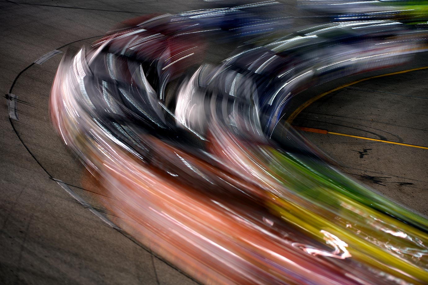 Cars race during the Federated Auto Parts 400 at Richmond International Raceway.