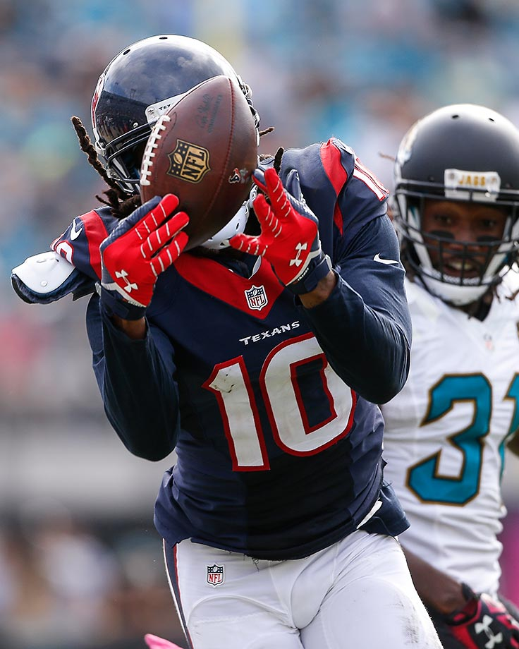 DeAndre Hopkins of the Houston Texans makes a catch using his facemask against the Jacksonville Jaguars. The Texans defeated the Jaguars 31-20.