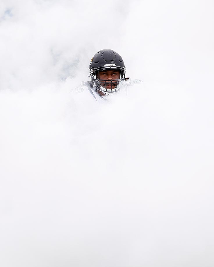 A.J. Cann of the Jacksonville Jaguars emerges from a cloud of smoke during the intro at a Houston Texans game.
