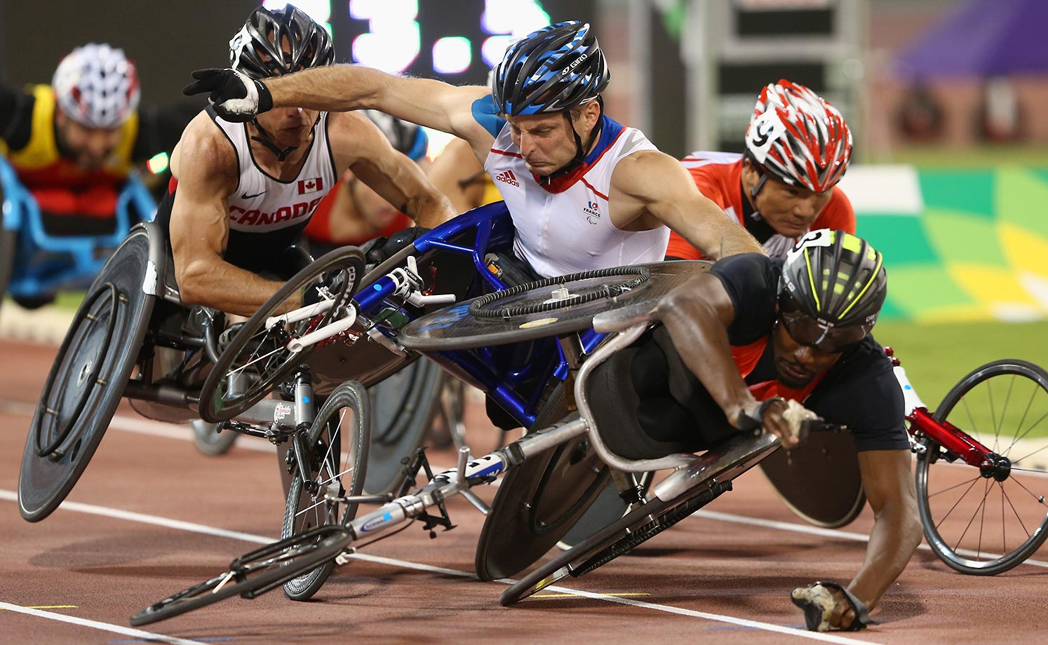Alhassane Balde (right) collides with Julien Casoli during the 1,500m T54 heats at the IPC Athletics World Championships in Doha, Qatar.