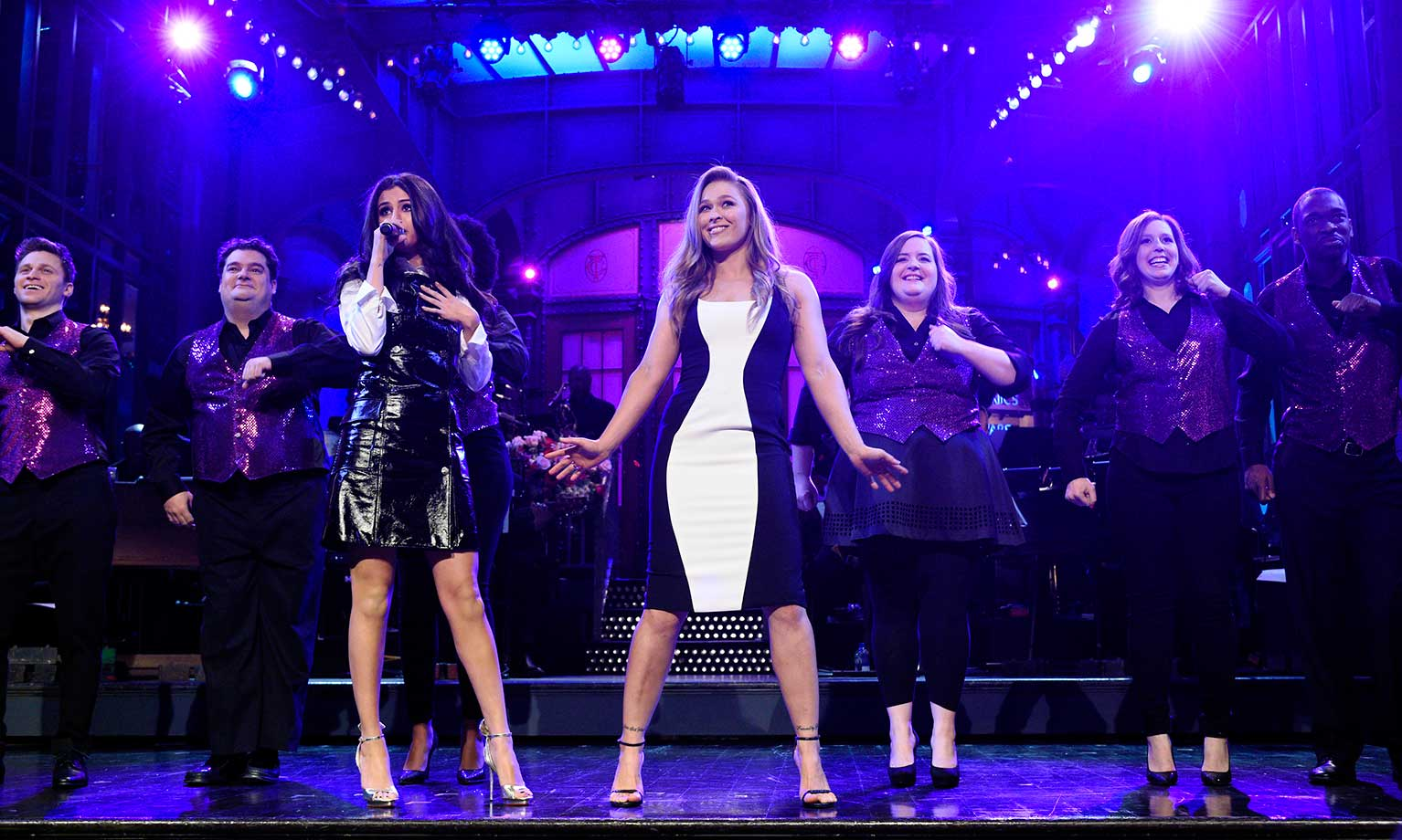 Ronda Rousey with SNL participants (from left) Jon Rudnitsky, Bobby Moynihan, Selena Gomez, Rousey, Aidy Bryant, Vanessa Bayer and Jay Pharoah during the monologue.