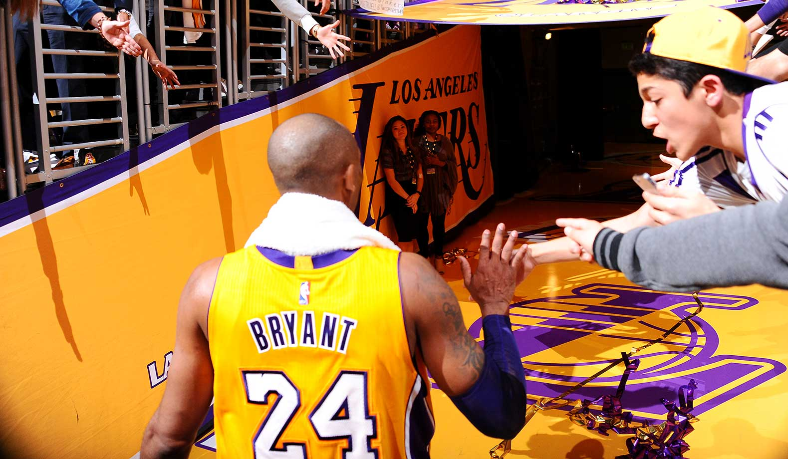 Kobe Bryant shakes hands with the fans after the game against the Minnesota Timberwolves.