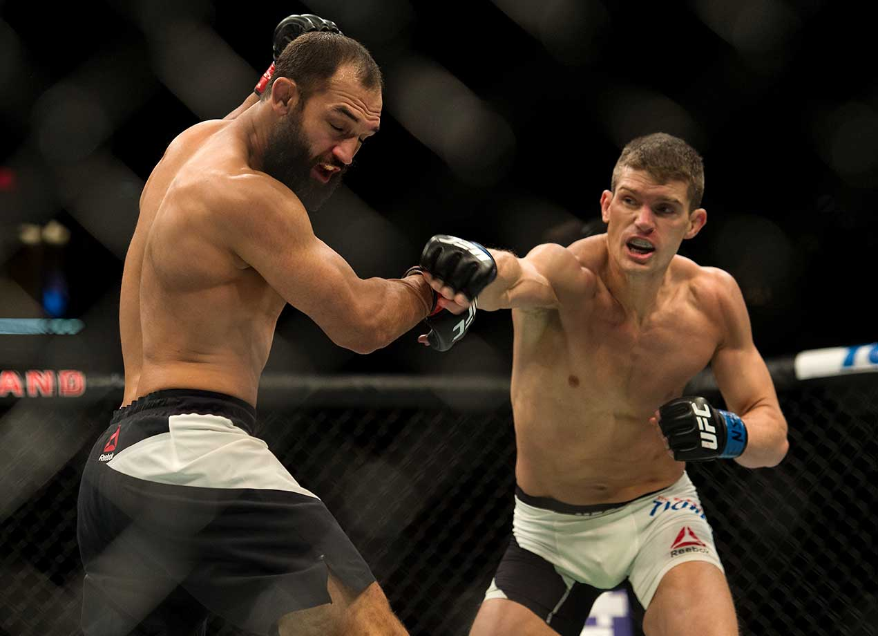 Stephen Thompson punches Johny Hendricks in their welterweight bout during UFC Fight Night Las Vegas.