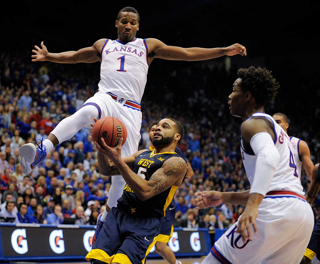 Here are some of the images that caught our eye on Feb. 9, starting with Wayne Selden Jr. skying high above Jaysean Paige of West Virginia.