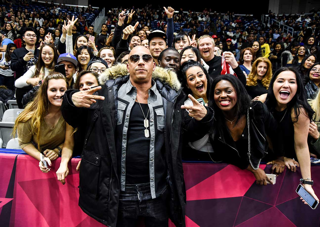 Actor Vin Diesel poses with fans at the 2016 NBA All-Star Celebrity Game at Ricoh Coliseum in Toronto, Canada.