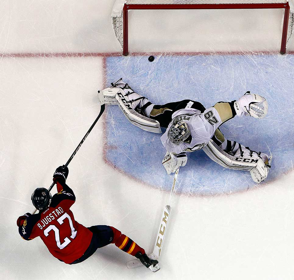 Nick Bjugstad of the Florida Panthers scores in a shoot out against Marc-Andre Fleury of the Pittsburgh Penguins.