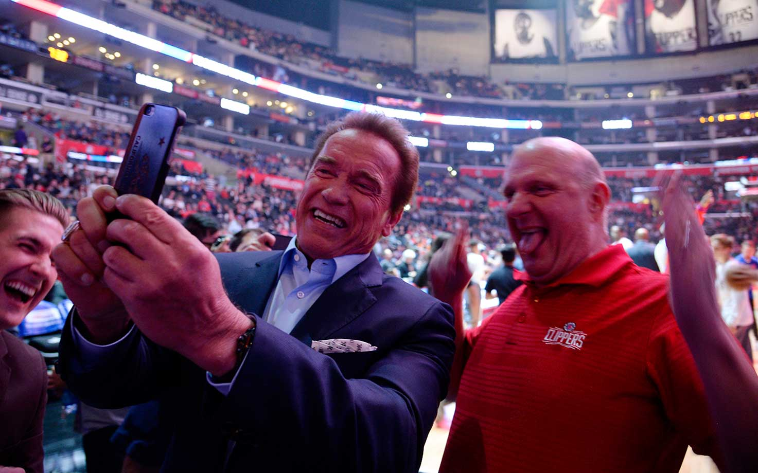 Actor and former governor of California Arnold Schwarzenegger and Clippers owner Steve Ballmer take a selfie during a game between L.A. and Phoenix.
