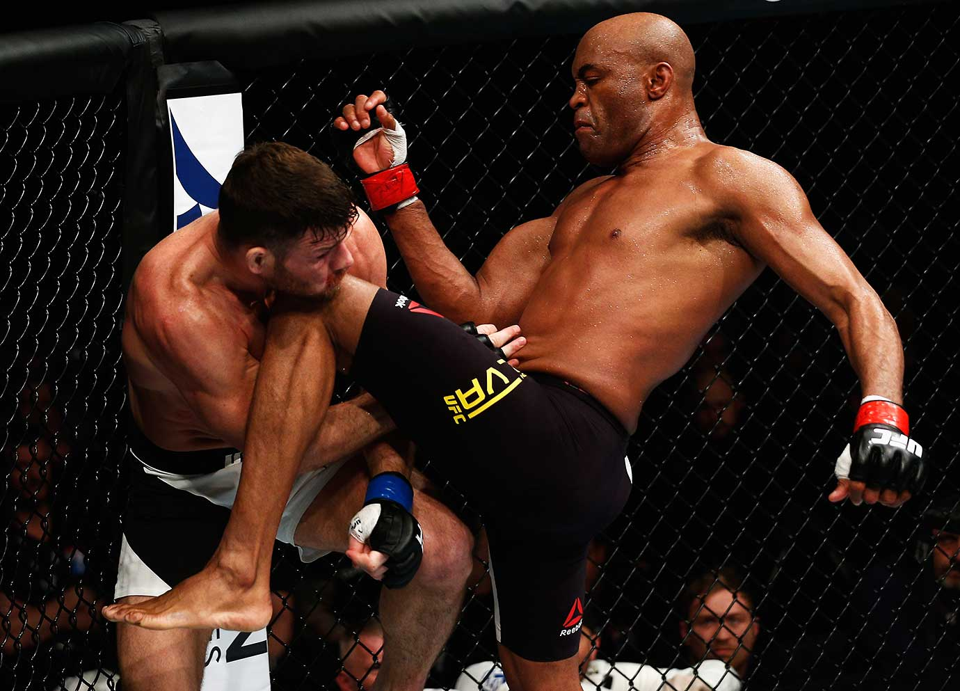 Anderson Silva of Brazil catches Michael Bisping of England with a knee to the chin.