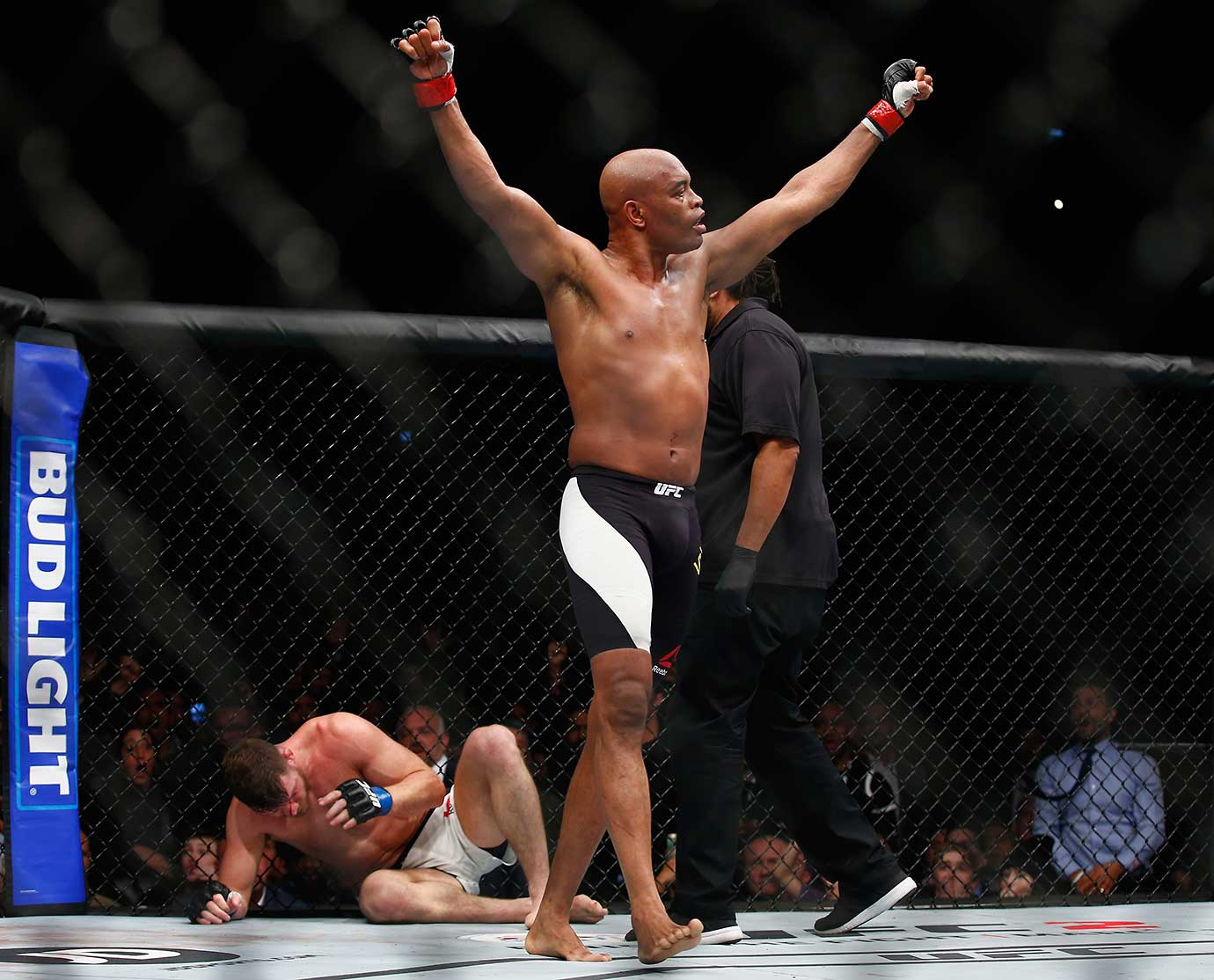 Anderson Silva of Brazil starts to celebrate, believing incorrectly that he had knocked out Michael Bisping.