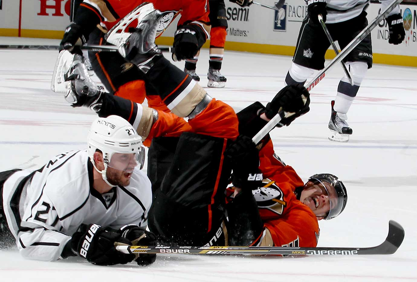 Jakob Silfverberg of the Anaheim Ducks collides with Alec Martinez #27 of the Los Angeles Kings.