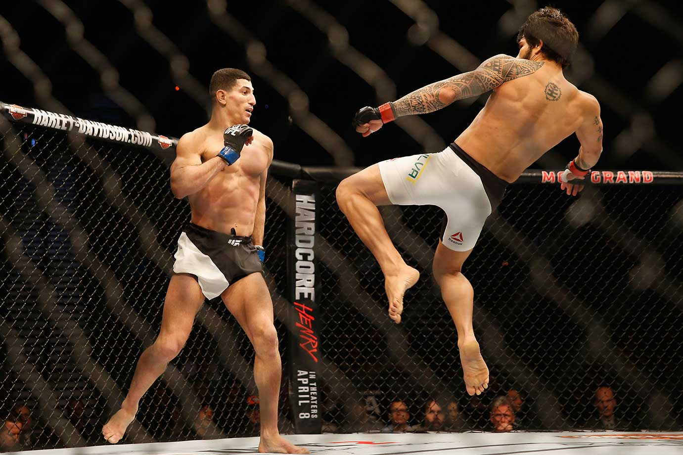 Erick Silva of Brazil kicks Nordine Taleb of France in their welterweight bout at UFC 196.