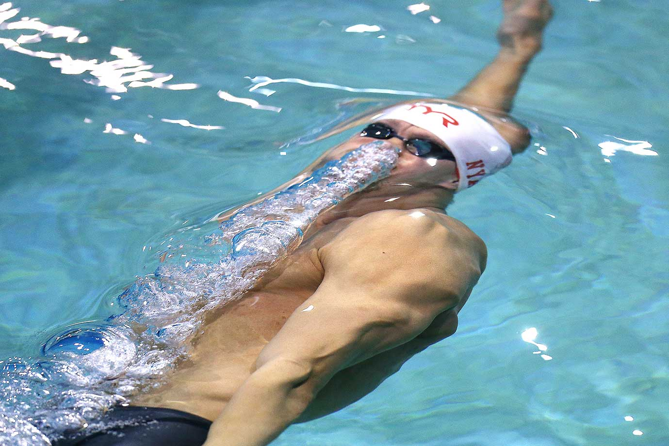 Arkady Vyatchanin swims in the 200-meter backstroke championship at the Arena Pro Swim Series in Orlando.