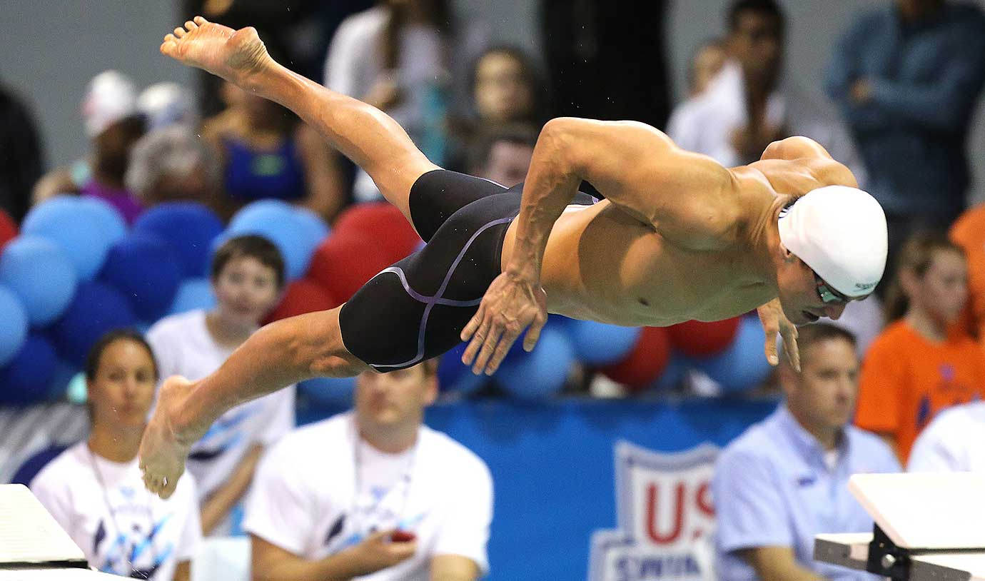 Nathan Adrian dives in to begin the 100-meter freestyle championship at the Arena Pro Swim Series in Orlando.