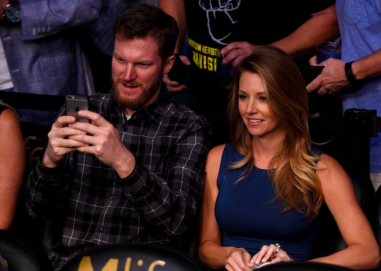 NASCAR driver Dale Earnhardt Jr. and girlfriend Amy Reimann at UFC 196.