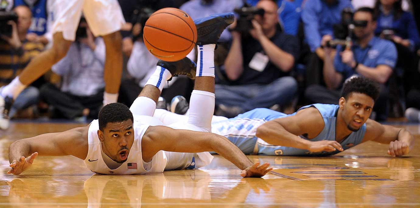 Matt Jones of Duke and Joel Berry II of North Carolina look toward a referee after fighting for a loose ball.
