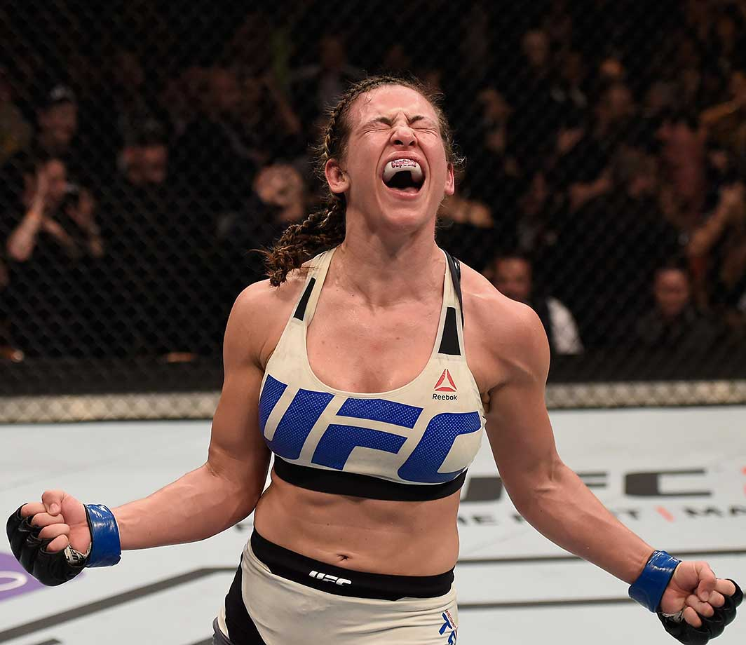 Miesha Tate reacts after her submission victory over Holly Holm in their UFC bantamweight title bout.