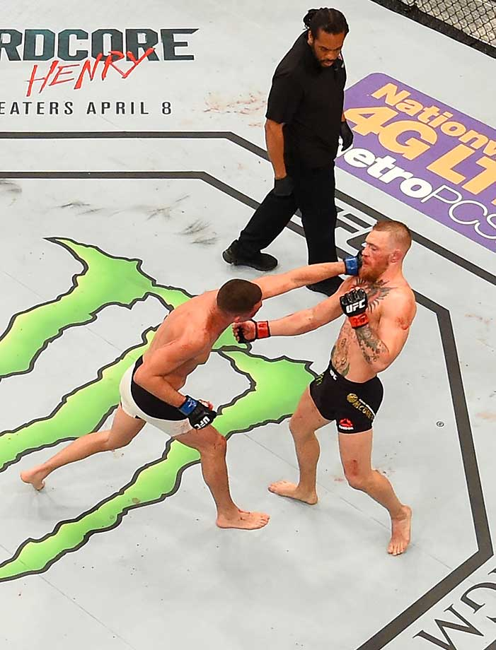 An overhead view of the Octagon as Nick Diaz defeats Conor McGregor of Ireland.