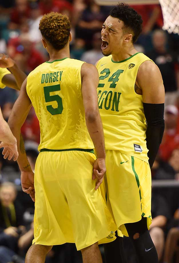 Tyler Dorsey and Dillon Brooks of the Oregon Ducks celebrate during a Pac-12 semifinal victory over Arizona in overtime.