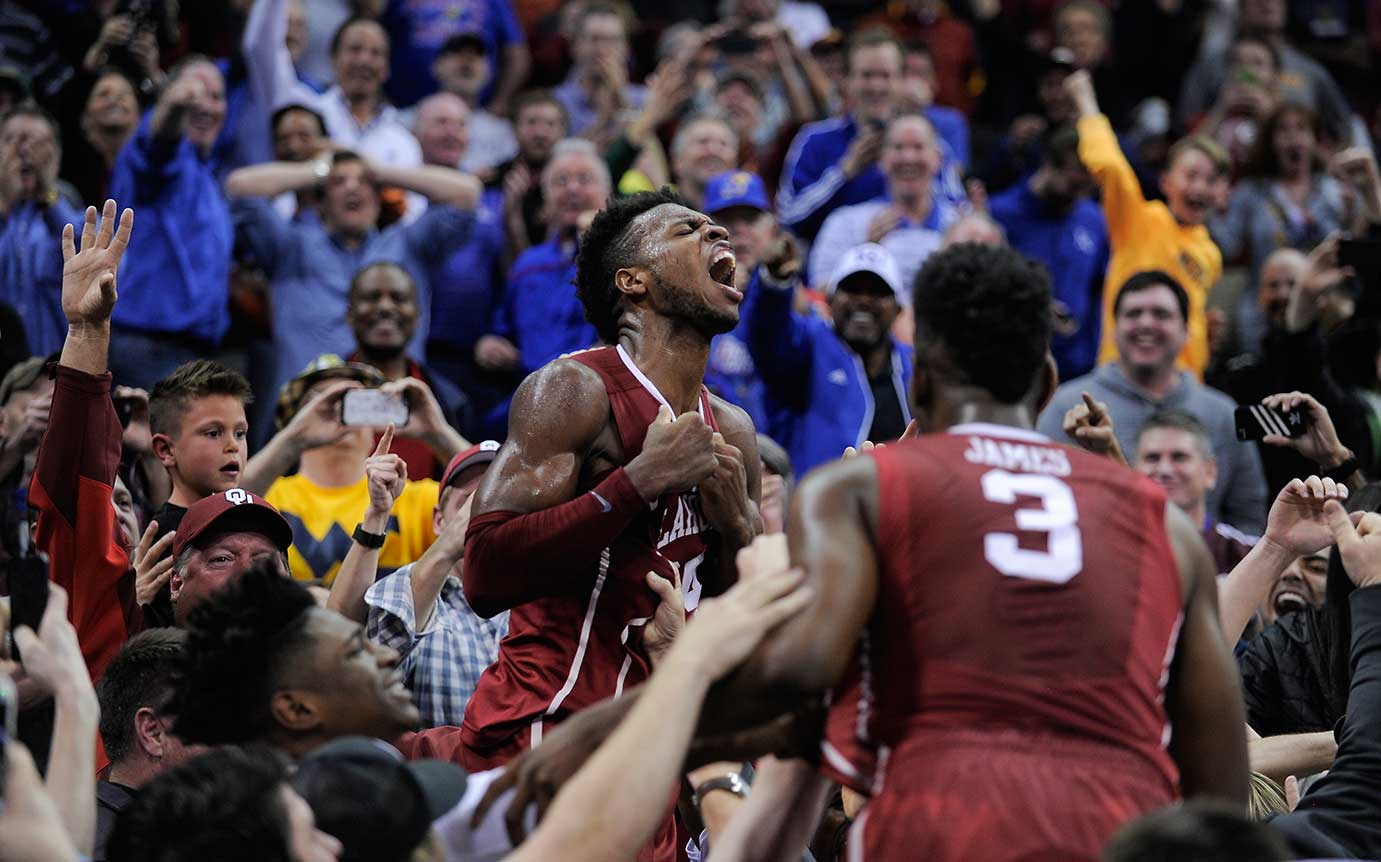 Buddy Hield of Oklahoma jumped into the stands to celebrate what he thought was a game-winning three-pointer against West Virginia. After watching replays, the officials waved off the shot.