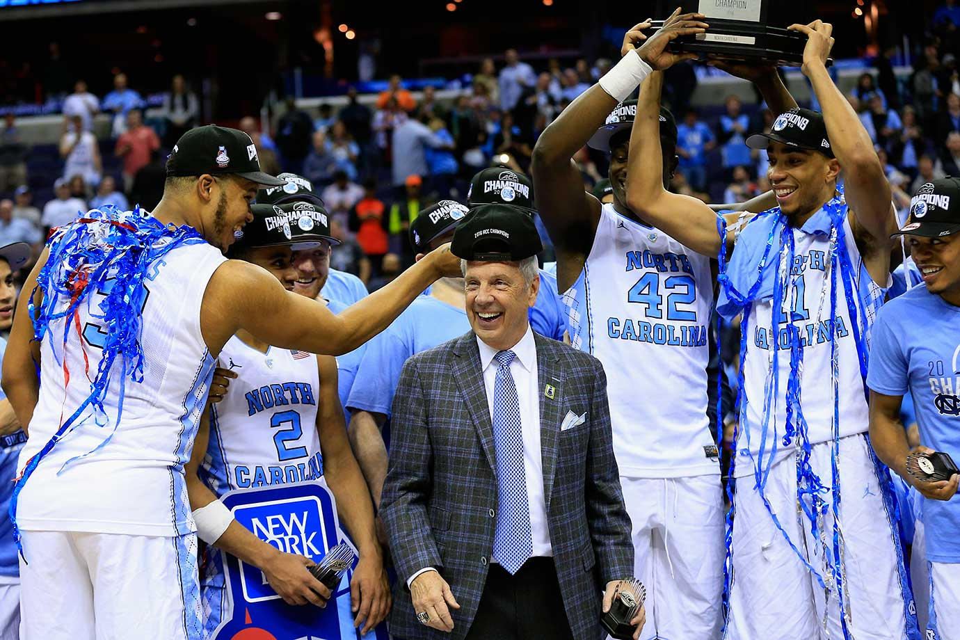 Kennedy Meeks goofs off with coach Roy Williams after North Carolina won the ACC Tournament with a victory over Virginia.