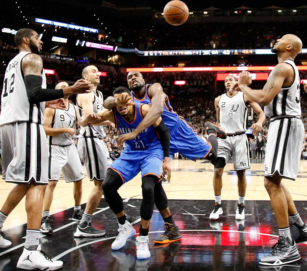 Serge Ibaka of Oklahoma City crashes into teammate Andre Roberson while driving to basket against the San Antonio Spurs.