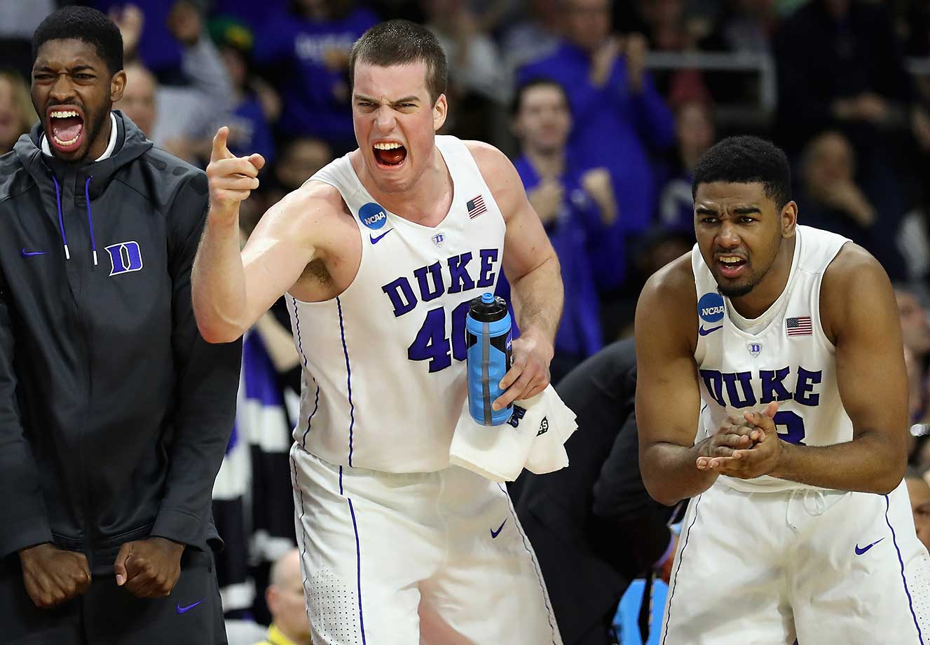 Marshall Plumlee (40) and Matt Jones (13) react in the second half of their win over North Carolina-Wilmington.