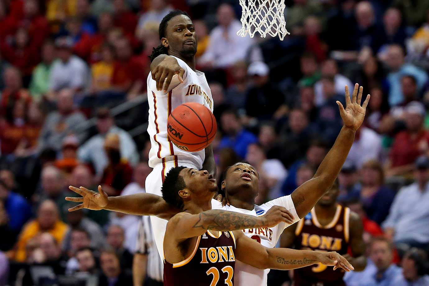 Jameel McKay of Iowa State blocks a shot by Jordan Washington of Iona.