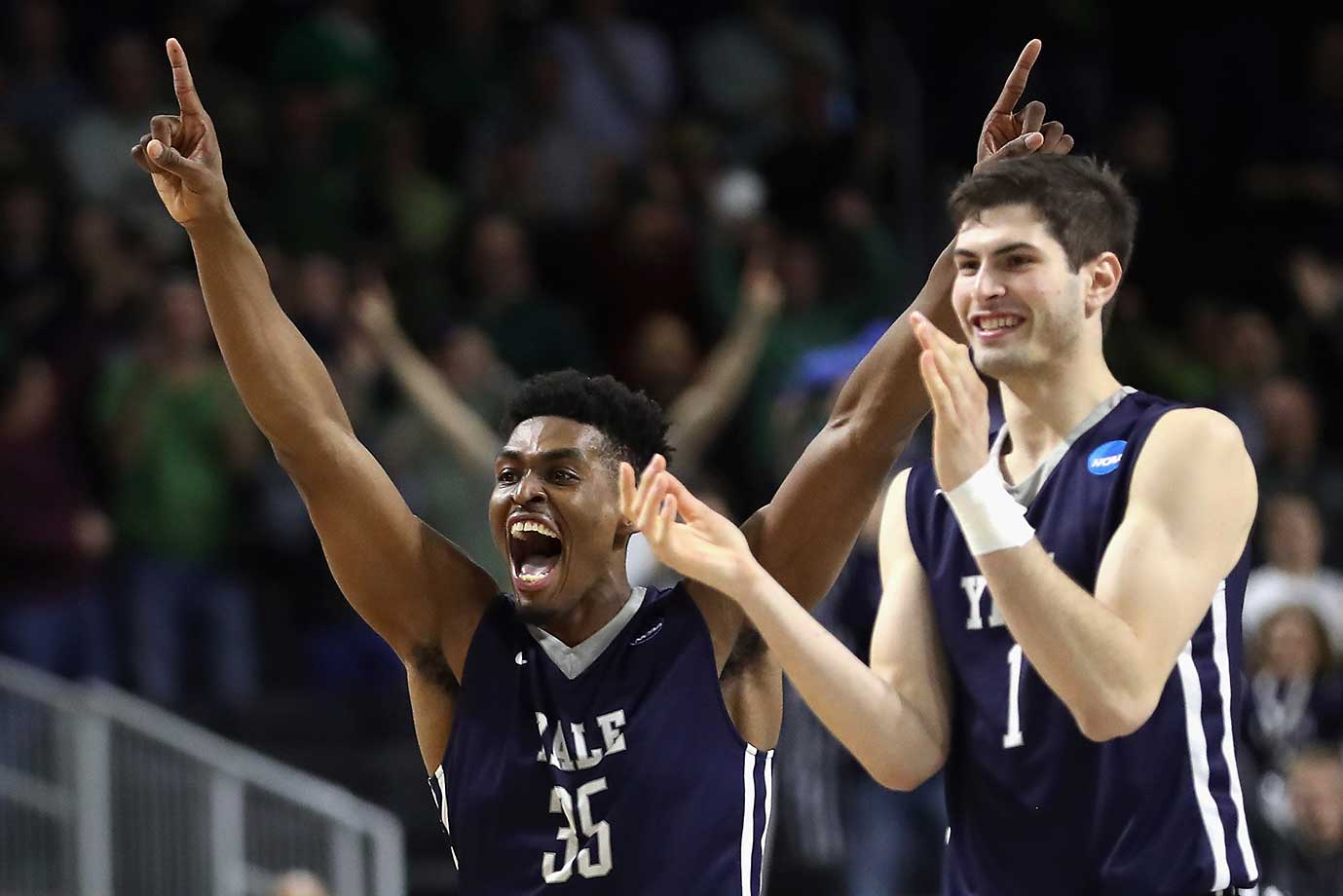 Here are some of the images that caught our eye on St. Patrick's Day, the first full day of the NCAA College Basketball Tournament, starting with Yale's upset of Baylor. Here, Brandon Sherrod, left, and Anthony Dallier celebrate the 79-75 victory.