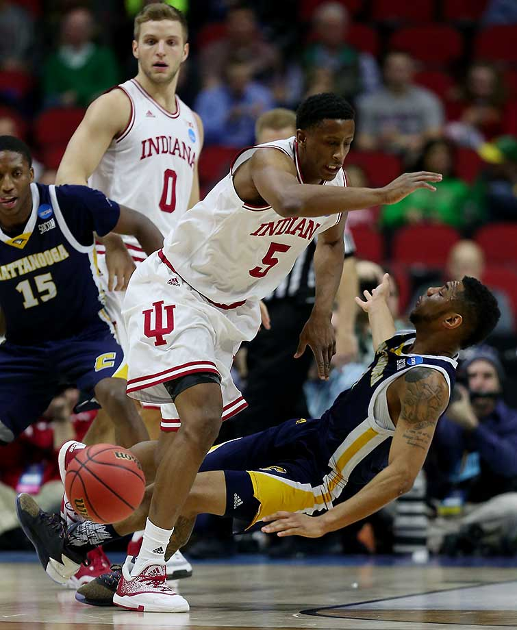 Johnathan Burroughs-Cook of Chattanooga is knocked over by Troy Williams of Indiana.